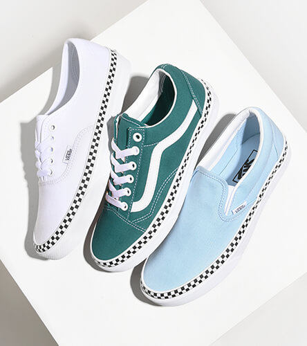 Shop Vans shoes, clothes, and accessories, featuring new spring styles like the check foxing blue Slip-On, green Old Skool, and white Authentic.