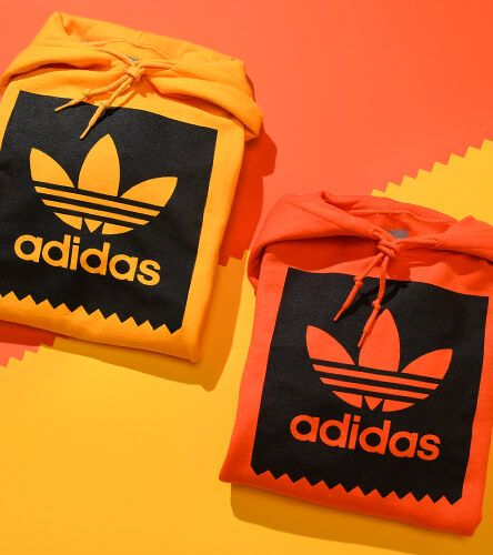 Orange & yellow adidas hoodies for men.