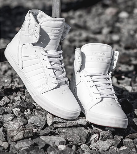 High top shoes and sneakers featuring the Supra Skytop in all white.