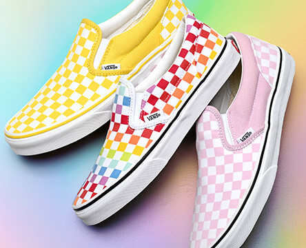 Shop kids' shoes featuring a collection of brightly colored Vans Checkered slip ons.