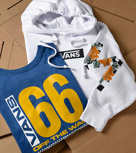 Vans clothing for women, featuring logo tees, hoodies & more.